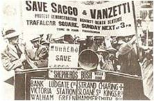 Newspaper clipping of protesters holding up signs during the Sacco and Vanzetti demonstrations, Boston, MA.