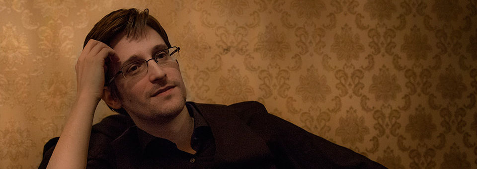 Edward Snowden sitting pensively.